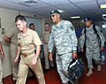 US Navy 051003-N-0780W-006 Commanding Officer, Medical Treatment Facility, Capt. Thomas Allingham, left, leads Commander, Joint Task Force Katrina, U.S. Army Lt. Gen. Russel Honore, to the wardroom mess for an assessment meetin.jpg