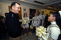 US Navy 051202-N-9693M-001 Chief of Naval Operations Mike Mullen explains to the Army cheerleader squad that the Navy will be victorious during the upcoming 106th Army-Navy football game.jpg