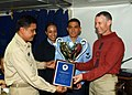 US Navy 060411-N-1941M-003 Lt. Cmdr. Eric Oxendine Assistant supply Officer assigned to the food service department aboard the amphibious assault ship USS Tarawa (LHA 1) accepts the much-sought-after Capt. Edward F. Ney Award.jpg