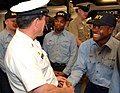 US Navy 060519-N-0962S-062 Master Chief Petty Officer of the Navy (MCPON) Terry Scott congratulates some of the Navy's newest Sailors as they receive their Navy ballcaps after successful completion of Battle Stations on board R.jpg