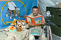 US Navy 060519-N-2300P-002 Equipment Operator 2nd Class Bryan Morgan assigned to Naval Mobile Construction Battalion Seven (NMCB-7) records himself reading stories to his children back home.jpg