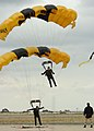 US Navy 061016-N-3488C-109 Two U.S. Army Golden Knight parachute team members land together at the Miramar Air Show.jpg