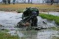 US Navy 061116-M-9827H-076 A marine with the People's Liberation Army (Navy) (PLA (N)) marine regiment, fights through a combat obstacle course at a naval base as part of a day of marine capability demonstrations.jpg
