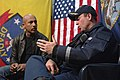 US Navy 061205-N-8148A-078 Cmdr. James Morgan, commanding officer aboard guided-missile destroyer USS Howard (DDG 83), speaks with Montel Williams aboard the ship.jpg