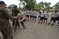 US Navy 070815-N-0989H-126 U.S. Marines assigned to a Mobile Training Team (MTT) demonstrate the proper procedures for searching and detaining an individual to Guatemalan sailors during U.S. Marine Corps Small Unit Tactical tra.jpg
