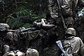 US Navy 070928-N-4267W-320 Seabees with Naval Mobile Construction Battalion (NMCB) 7 transport a simulated casualty up a hill during a jungle warfare training.jpg