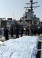 US Navy 080824-N-4044H-114 Sailors aboard the guided-missile destroyer USS McFaul (DDG 74) unload humanitarian supplies to be put on to pallets and then transported to the people of Georgia.jpg