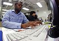 US Navy 090226-N-9928E-036 Personnel Specialist Seaman Orvin McLean uses a keyboard to enter personnel data into Sailors digital service records.jpg