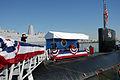 US Navy 090305-N-7705S-145 Cmdr. Howard Goldman salutes the national ensign as he departs USS Toledo (SSN 769).jpg