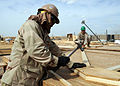 US Navy 090505-N-9410R-119 Builder 3rd Class Arturo Arellano and Cpl. Jason Laib build a truss at the Barley Company Prefabrication Yard at Camp Natasha.jpg