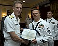 US Navy 090521-N-1722M-120 Chief of Navy Reserve Vice Admiral Dirk Debbink presents the Navy and Marine Corps Commendation Medal to Naval Aircrewman 1st Class William J. Frost, assigned to Helicopter Sea Combat Squadron (HSC) 8.jpg