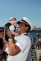 US Navy 090616-N-3038W-187 Lt. Brian Broadwell holds his nine-week old daughter for the first time after returning from a scheduled five-month deployment aboard the guided-missile destroyer USS Kidd (DDG 100).jpg