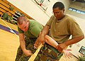 US Navy 090817-N-9573A-039 Lance Cpl. Michael Sulzener, left, from Canadagiva, N.Y., and Electronics Technician 2nd Class Demetrius Peavy, from Pahokee, Fla., practice hand-to-hand combat skills.jpg