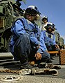 US Navy 091008-N-5345W-017 Seaman John Mendez, left, Boatswain's Mate Seaman Antoinette Smith and Boatswain's Mate 1st Class Jay Collette watch an approaching helicopter from the flight deck of the amphibious dock landing ship.jpg