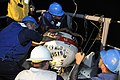 US Navy 091115-N-8335D-285 Sailors secure a dummy mine brought aboard the mine countermeasures ship USS Ddefender (MCM 2).jpg