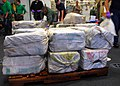 US Navy 100304-N-7058E-086 Bales of cocaine are stacked in the airborne mission zone aboard USS Freedom (LCS 1) after they were seized from a go-fast small boat.jpg