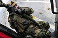 US Navy 100320-N-8878B-004 Explosive Ordnance Disposal Technician 1st Class Ryan Freeman prepares to fast-rope during an air power demonstration aboard the aircraft carrier USS Carl Vinson (CVN 70).jpg