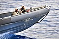 US Navy 100407-N-4774B-267 Members of a visit, board, search and seizure team assigned to the littoral combat ship USS Freedom (LCS 1) conduct tactical exercises in a rigid-hull inflatable boat.jpg