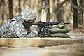 US Navy 110426-N-TH989-090 Chief Aviation Structural Mechanic Raymond Vasquez fires his M4 rifle during the U.S. Navy Individual Augmentee Combat T.jpg