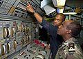US Navy 110727-N-OV802-015 Lt. Aaron Jefferson trains Djiboutian navy Lt. Mahdi Daher Miguil at the main propulsion console aboard USS Samuel B. Ro.jpg