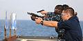 US Navy 111007-N-MW330-044 Seaman Brandon Snook fires a 9mm pistol on the flight deck of the forward-deployed amphibious dock landing ship USS Germ.jpg