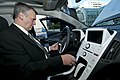 US Navy 111020-N-PM781-010 Tom Hicks, Deputy Assistant Secretary of the Navy for Energy, tests a Chevrolet Volt electric car after accepting the ve.jpg