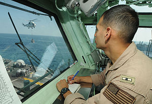 US Navy 111223-N-KA046-006 Chief Warrant Officer Robert Reyes takes notes during a vertical replenishment aboard the multipurpose amphibious assaul.jpg