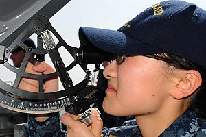 US Navy 111224-N-ED900-015 Ensign Jiatian Yue, assigned to the guided-missile destroyer USS Pinckney (DDG 91), uses a statometer to measure range a.jpg