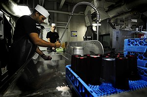 US Navy 120131-N-MD252-362 Sailors wash dishes in the scullery.jpg