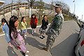 US Soldiers interacting with children in the DMZ.jpg
