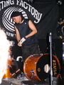 Uki Eiji of Melt-Banana dismantles his drum kit.png