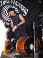 Uki Eiji of Melt-Banana dismantles his drum kit.png