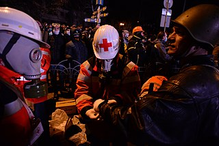 Ukrainian Red Cross Society volunteers administering first aid to a wounded Euromaidan protester. Events of Jan 19, 2014-6.jpg