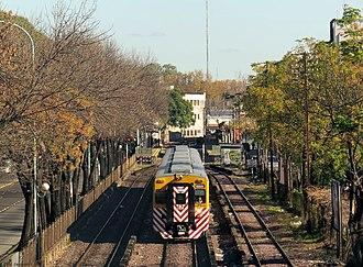 Urquiza Line - Urquiza Line Toshiba EMU leaving José Artigas station for the Federico Lacroze terminus.