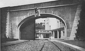 Rail transport in Vatican City - Gateway in the Vatican with sliding door built in the wall surrounding the Vatican, which admits the railway to the Vatican station. Railway Magazine (1934)