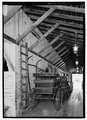 View of hay loft ladder in north bay from east looking west. - Livery-Plaza Stable, San Juan Bautista, San Benito County, CA HABS CA-2735-16.tif