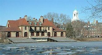 Weld Boathouse - Weld Boathouse from the Charles River, with Harvard University buildings visible in the background and the partially frozen Charles River in the foreground