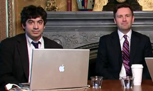 West Wing Week - Arun Chaudhary and Josh Earnest.png