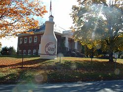 "The ""Whately Milk Bottle"" in front of the old Whately Central School (built 1910)"