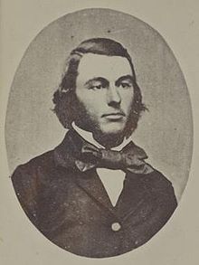 portrait photo of a man about 30 with sideburns