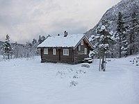 Winter view of typical norwegian hytte (cabin) coverd in snow in Rekdalsetra area - Rekdal, Vestnes, Norway 2017-12-29.jpg