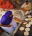 Women preparing roti for visitors of Harmandir Sahib rotated cropped.jpg