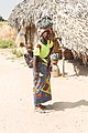 Young female with her child on her back in Gambia.jpg