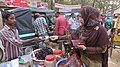 Young girl buys pickles from street vendor 1.jpg