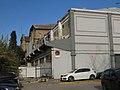 008 Antiga fàbrica Uralita, cra. de Barcelona 135 (Cerdanyola del Vallès), façana c. Sant Quintí.jpg