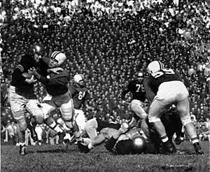 Crab Bowl Classic - A Terrapin tackles a Midshipman in the 1952 game.