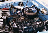 "Shows the engine compartment with a ""Go Package"" 390 CID V8"