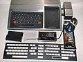 1979 TI-99-4 with Speech Synthesizer, RF modulator, keyboard overlays (adjusted).jpg