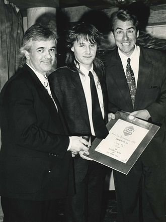 "Golden Joystick Awards - 1989/1990: Paul Patterson of Ocean Software receive, from Jonathan Ross, ""Best Coin-Op Conversion of the Year"" (8-bit) award"