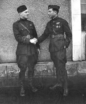 Remicourt Aerodrome - Lieutenant William Portwood Erwin, 1st Aero Squadron, being congratulated by Captain A. J. Coyle, Commander, First Army Observation Group on achieving air ace status,  October 1918